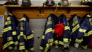 Firefighters' jackets and helmets are hung on a wall in the main fire hall in West Webster, New York, December 28, 2012. REUTERS/Carlo Allegri