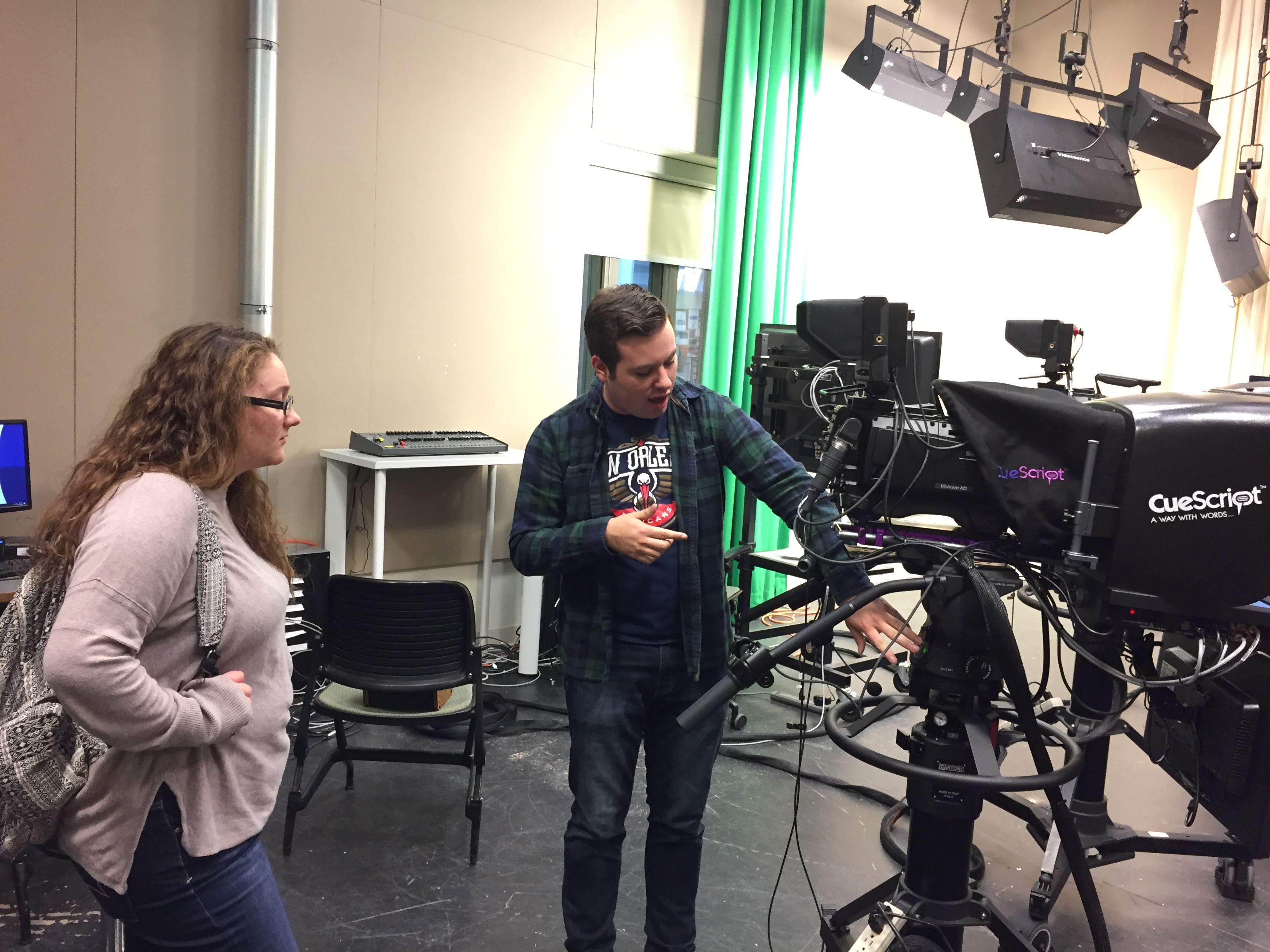 Ryan Berger '18, shows a crew member how to use our new HD cameras